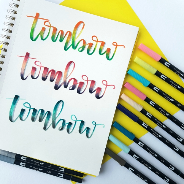 Image showing 3 different ways to create blended lettering with the 12 new coloured Tombow dual brush pens. The word Tombow is lettered three times and shows three different colour blended combinations